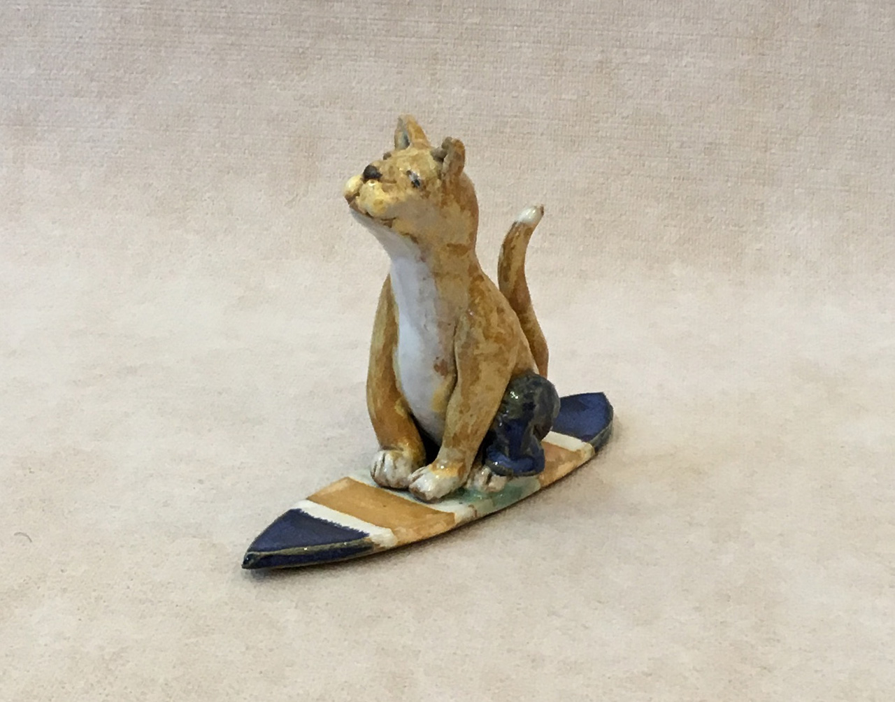 Surfing Cat by Robin Fahey Cameron hand built clay