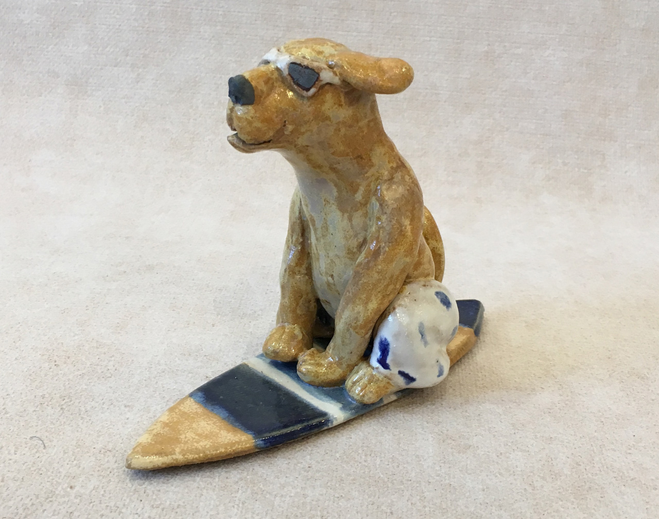 Surfing Dog by Robin Fahey Cameron hand built clay