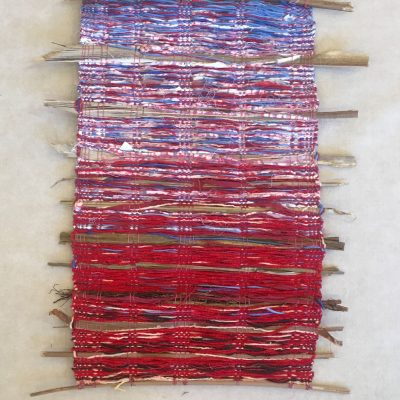 Multi-fiber wall hanging in reds, whites, and blues