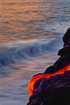 """Endless Balance"" by Brad Lewis lava flowing into ocean as waves come in"