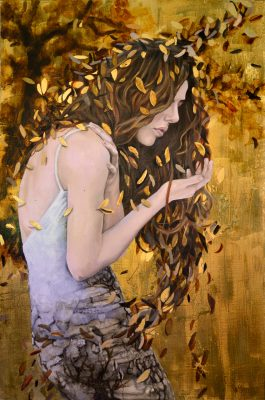 Woman with long hair covered in leaves