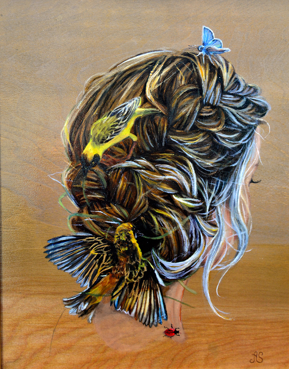Back of woman's head with birds braiding her hair