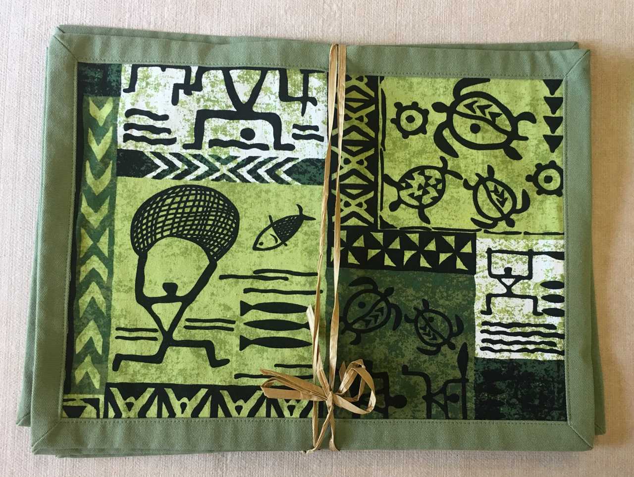 Green Petro Placemat Set by Bonnie Warren in green and black petraglyph design