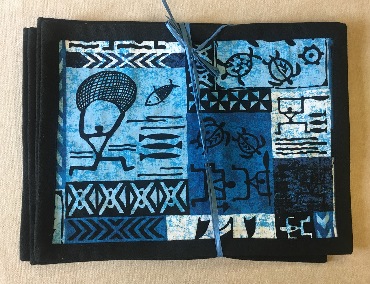 Blue Petro Placemat Set by Bonnie Warren in blue and black petraglyph