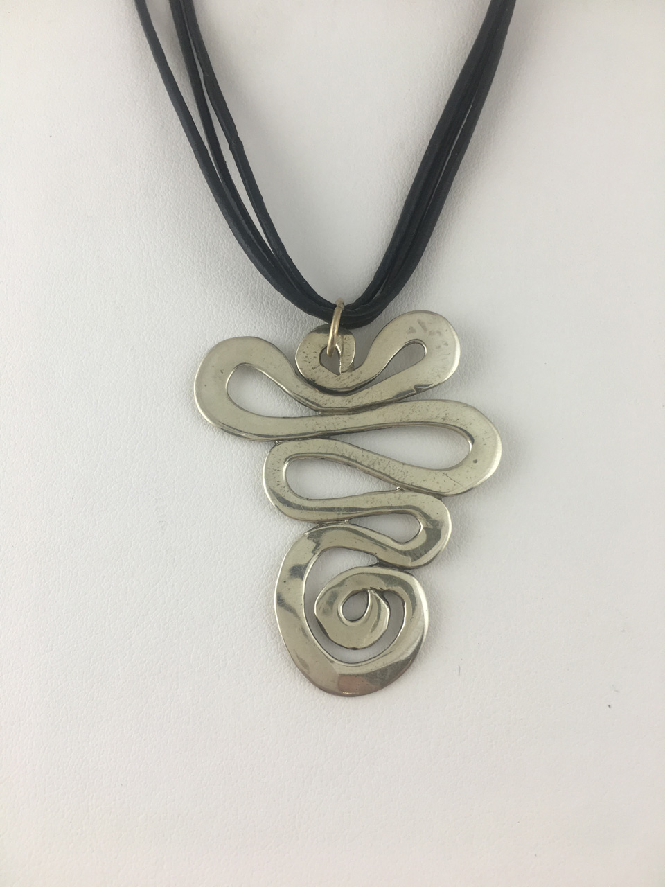 Silver with Leather Cord Long Hammered Swirl Necklace by Dian Anderson