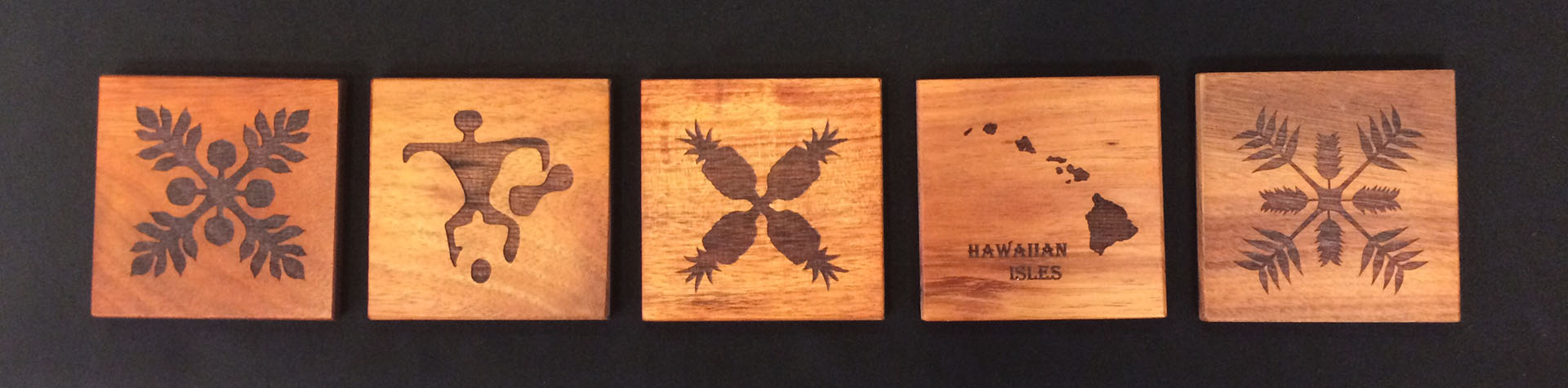 Five Engraved Koa Coasters with different designs