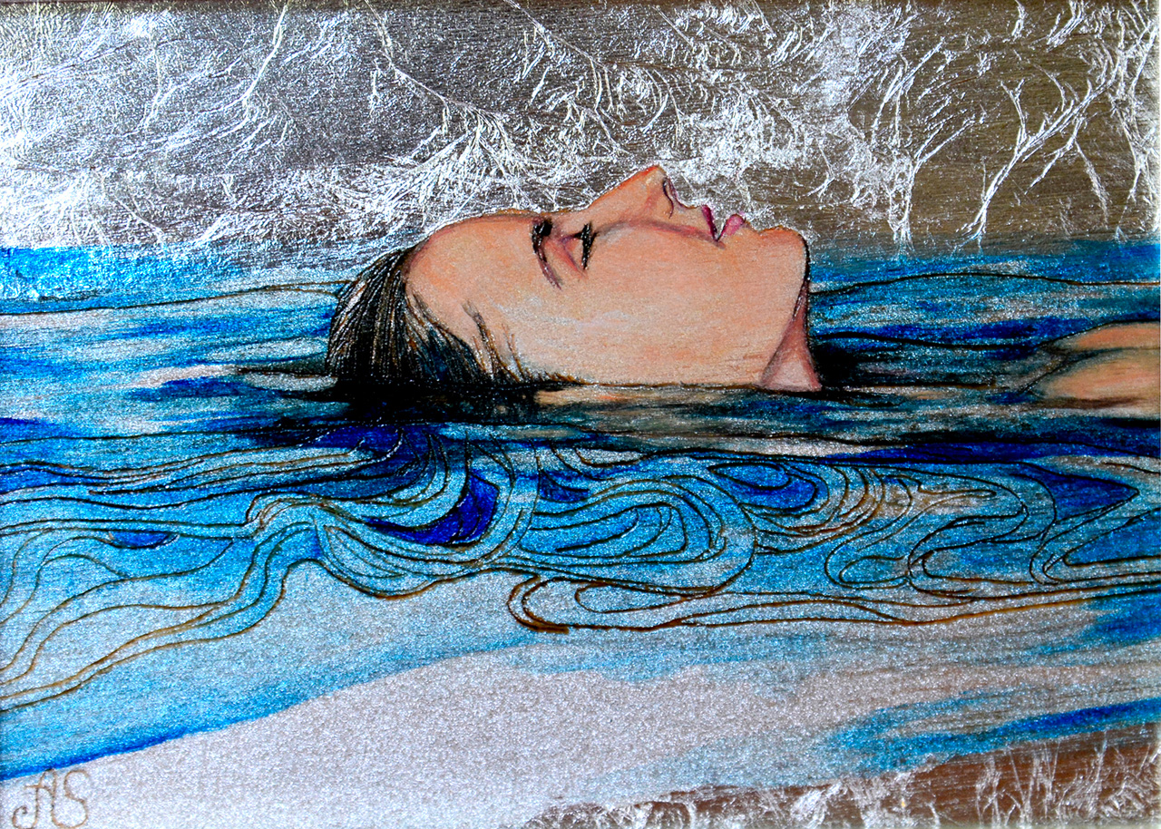 Woman's face floating in water