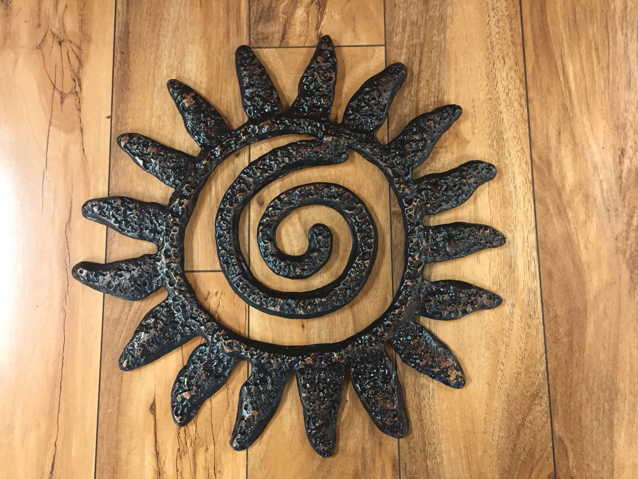 Spiral Sun by Charlie Corda wall hanging sculpture
