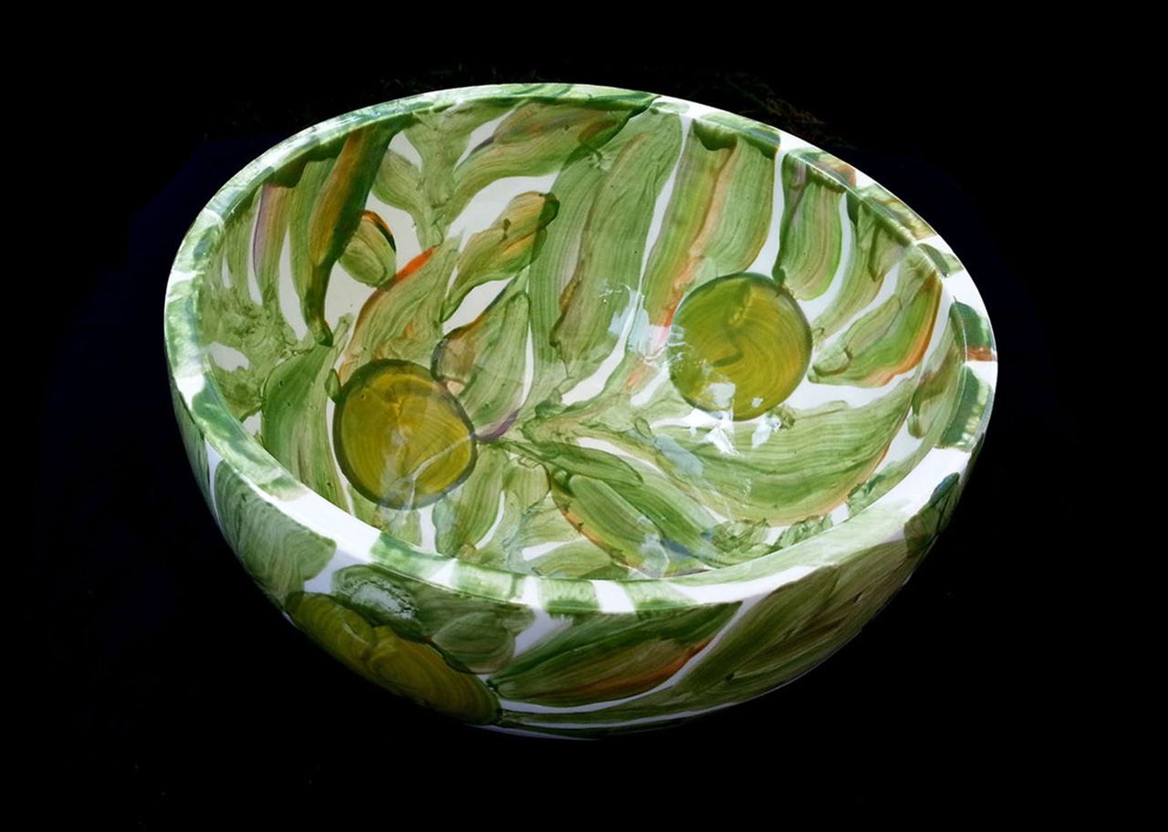 ceramic bowl painted green leaves and breadfruit