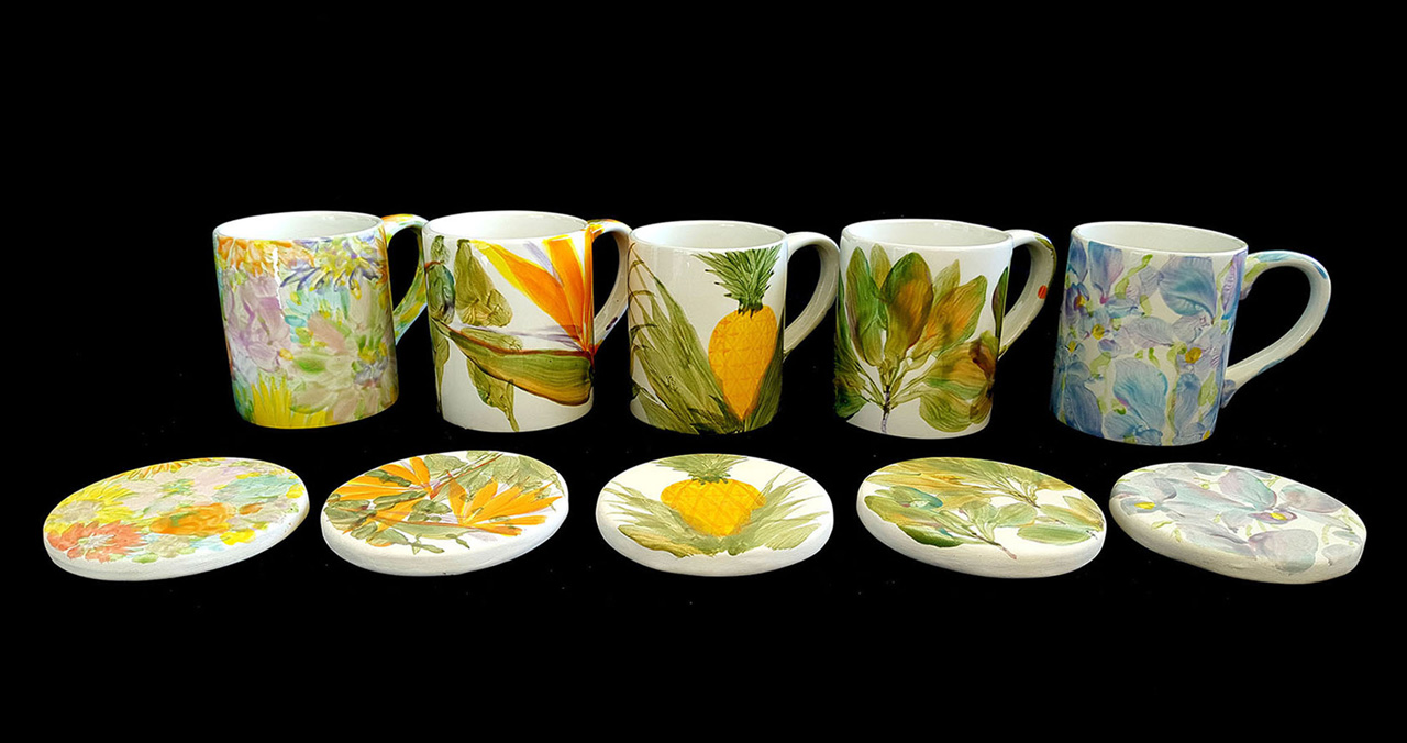 five hand painted mugs with their matching coasters