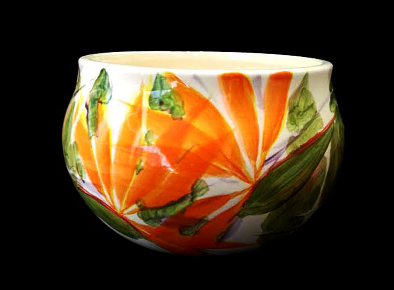 a ceramic planter bowl with bird of paradise flowers painted