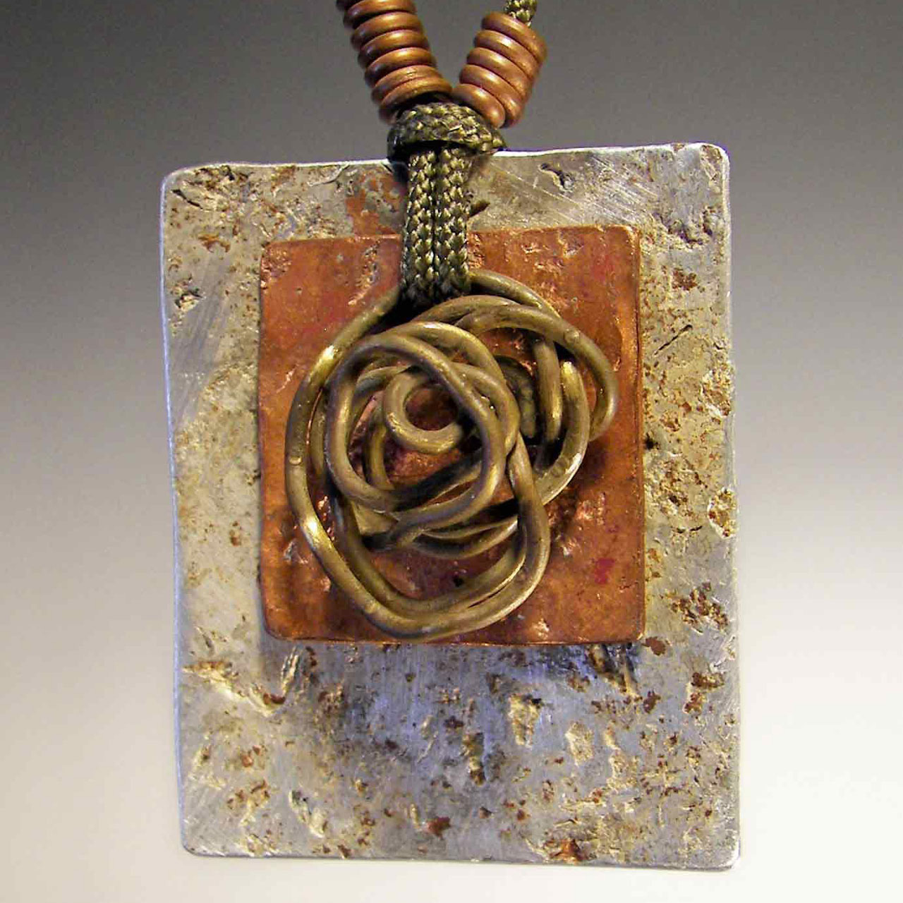 Nesting Necklace by Mckenna Hallett mixed metal