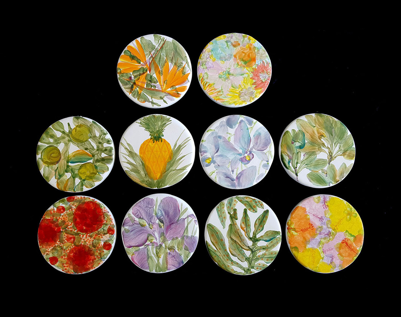 Ten circular coasters hand painted with various Hawaiian plants