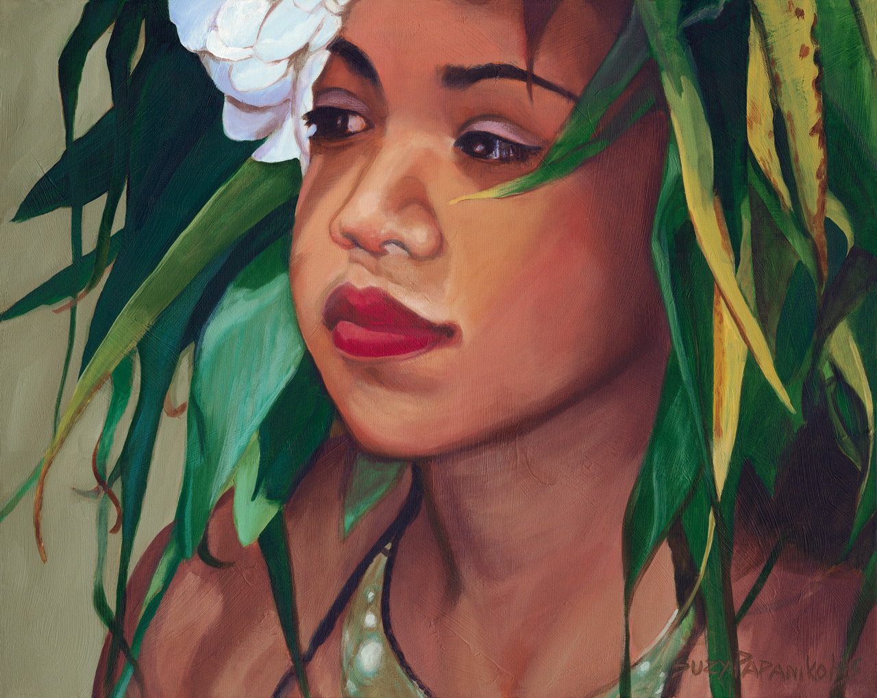 Portrait of a young hula girl with a ti leaf haku and white plumeria flowers in her ear