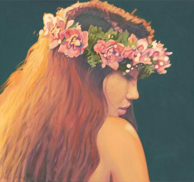Side profile of a female hula dancer with a pink orchid head piece and long brown hair