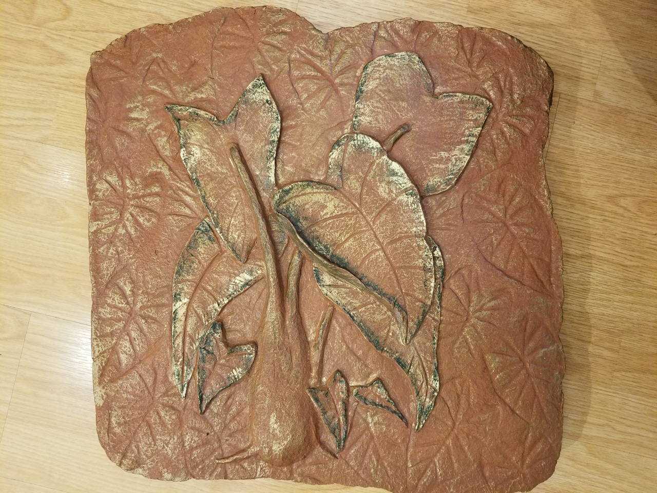 Taro by Kalei Engel depicting taro leaves in Hawaiian red clay and paper medium with gold accents