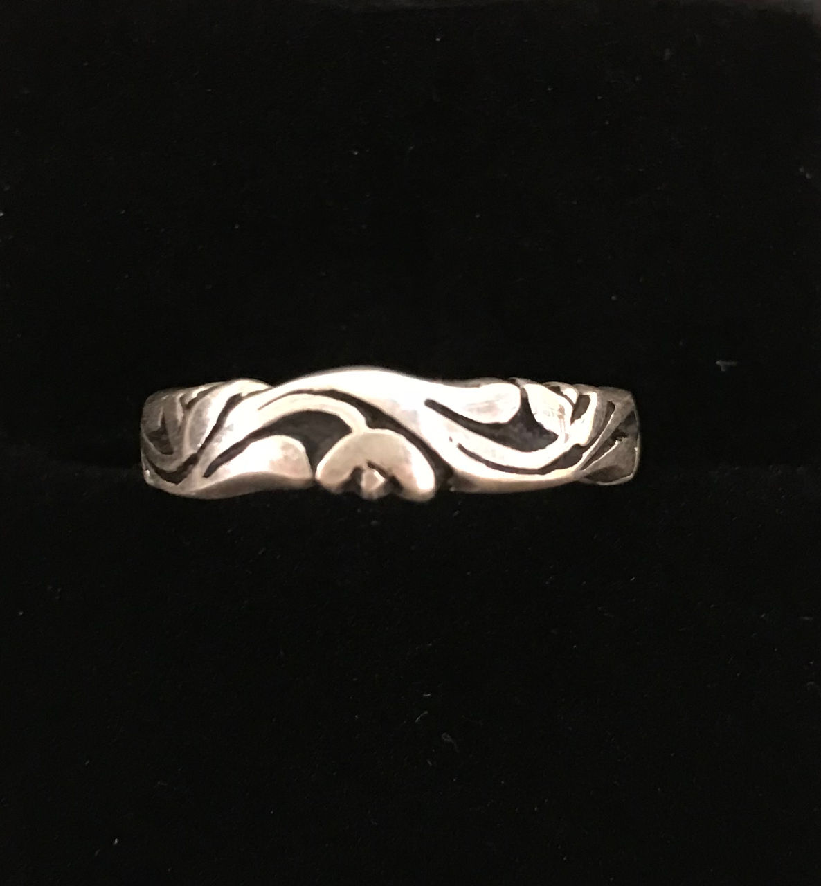 sterling silver thin band ring with flow lines and black in vacant spaces