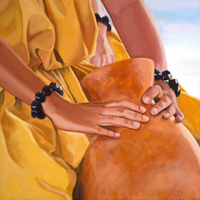 The hands of a young hula dancer wearing yellow holding an ipu