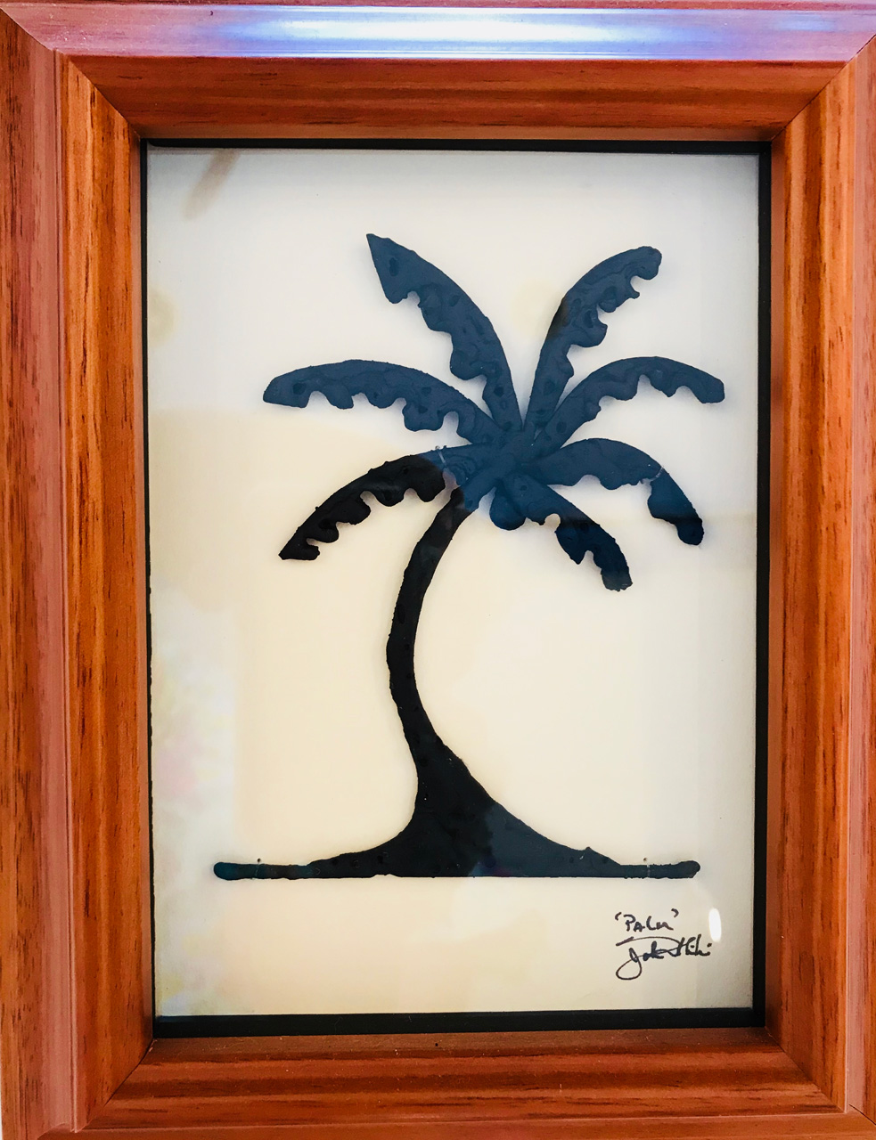 Framed metal sculpture entitled Cocunut Palm Tree by John Ilnicki