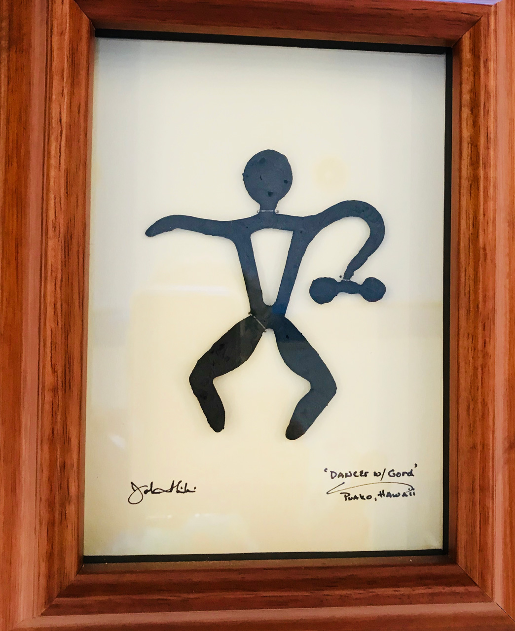 Framed metal sculpture entitled Dancer with Gourd by John Ilnicki