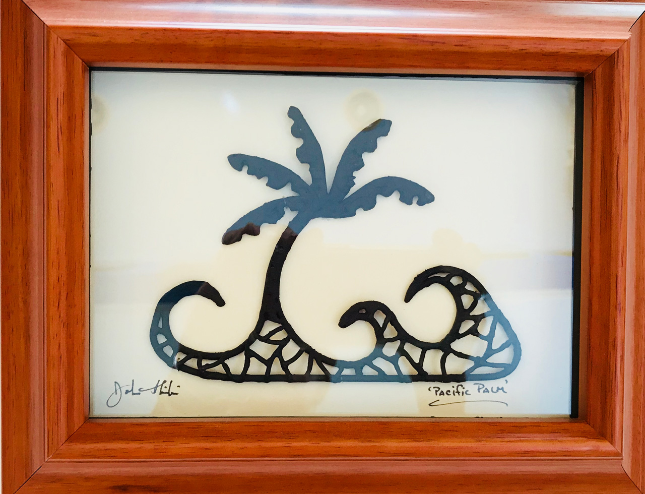 Framed metal sculpture titled Ocean Palm by John Ilnicki