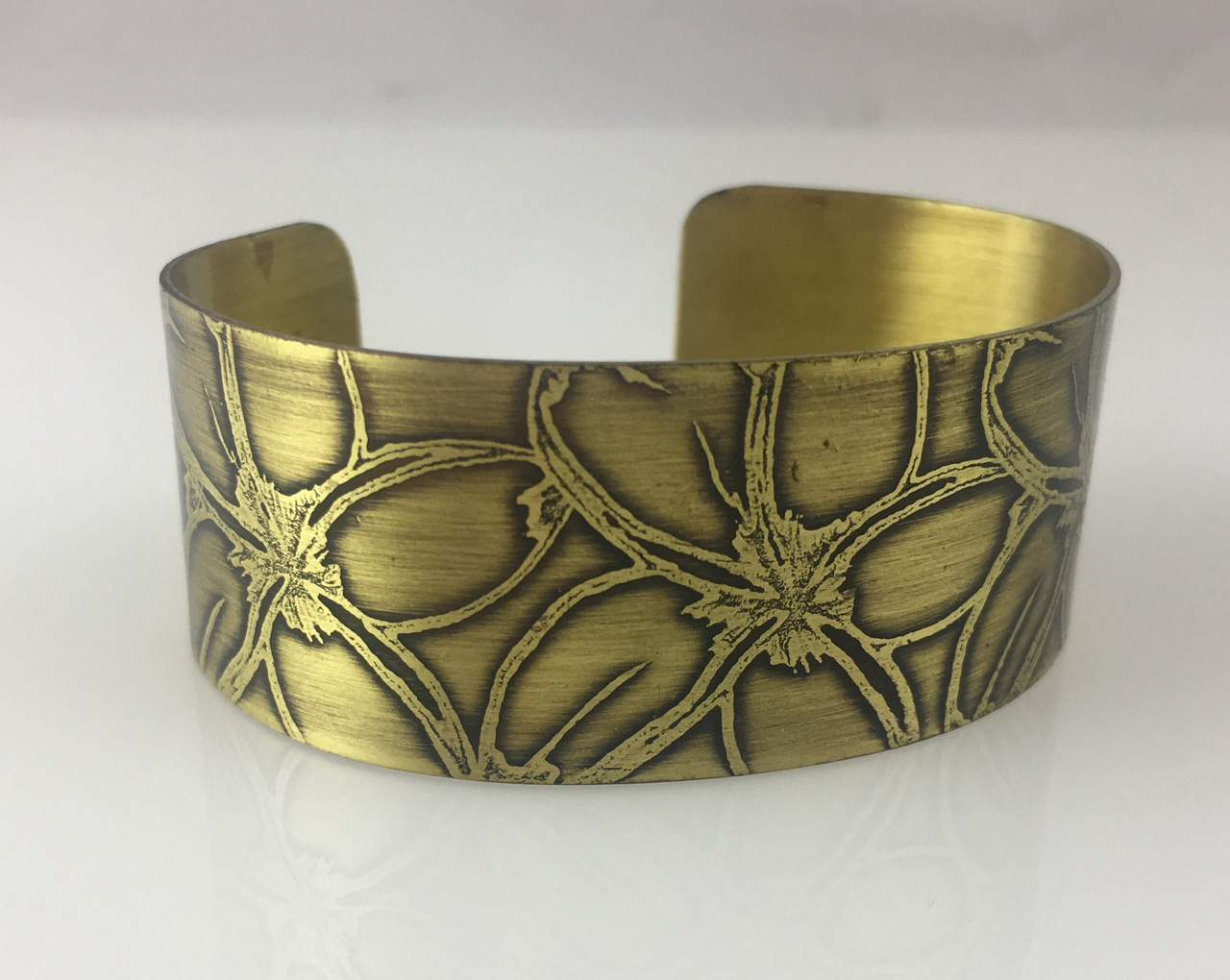 Brass Bracelet with Etched Plumeria Flowers by JoAnna Hernandez