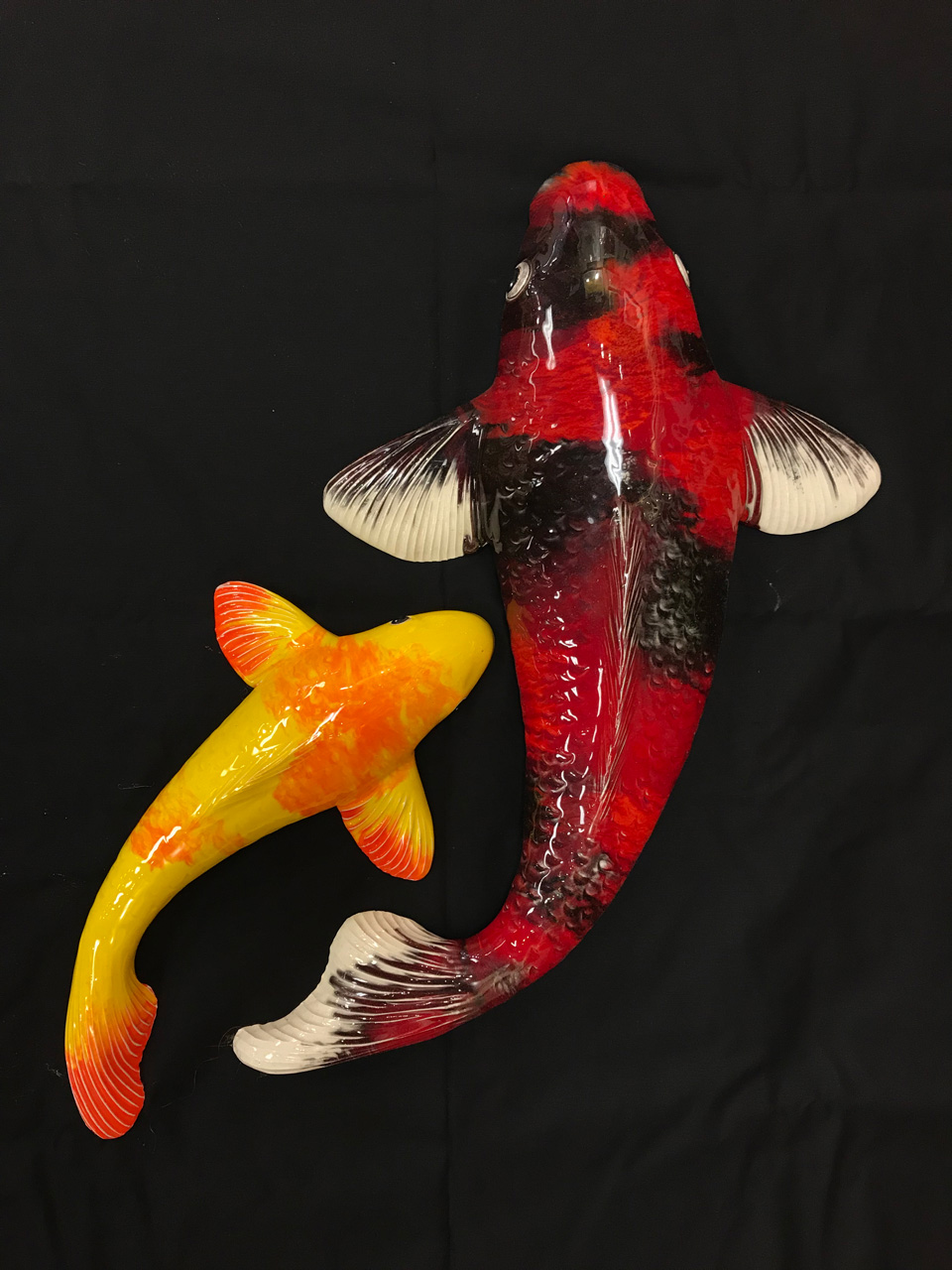 Ceramic Large and Small Koi by Mark MacKay with red and black and orange and yellow glaze
