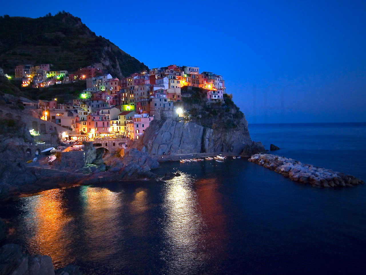 Manarola Night by Marty Wolff night sky with city in the background