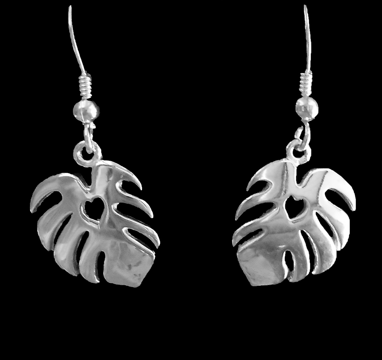 sterling silver earrings of monstera leafs with heart cutout centers