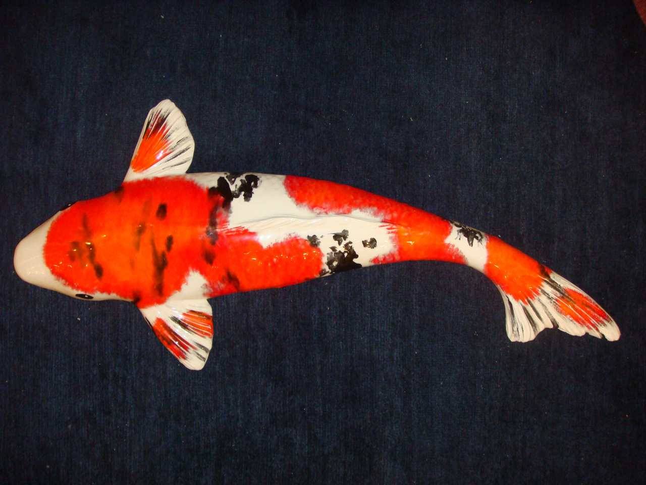 Ceramic Koi by Mark MacKay with orange and black glaze