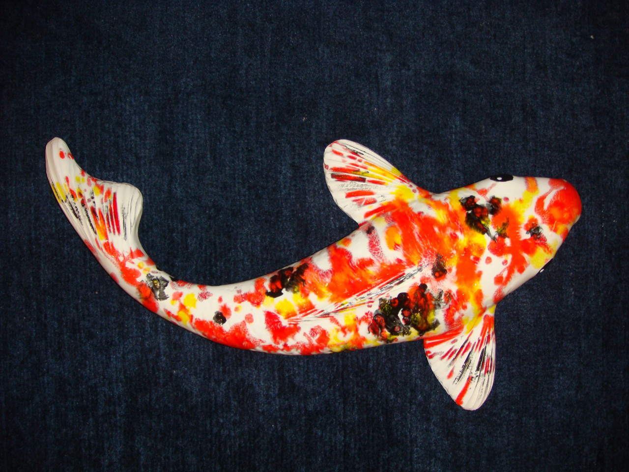 Ceramic Koi by Mark MacKay with orange, yellow, and black glaze