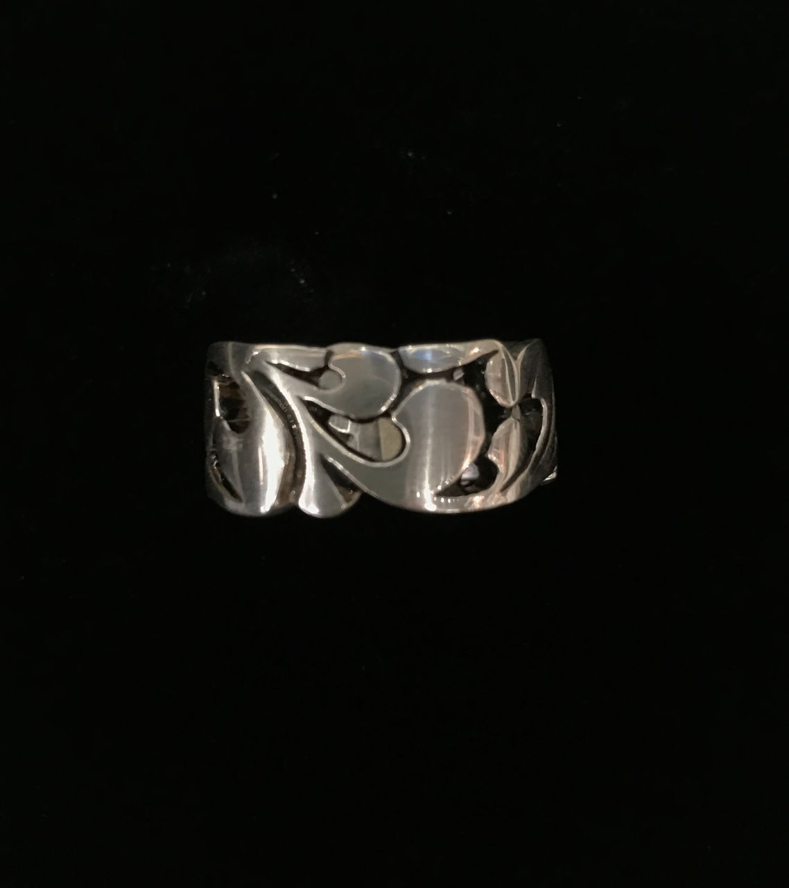 sterling silver ring wide band with flow design. areas to see through to finger