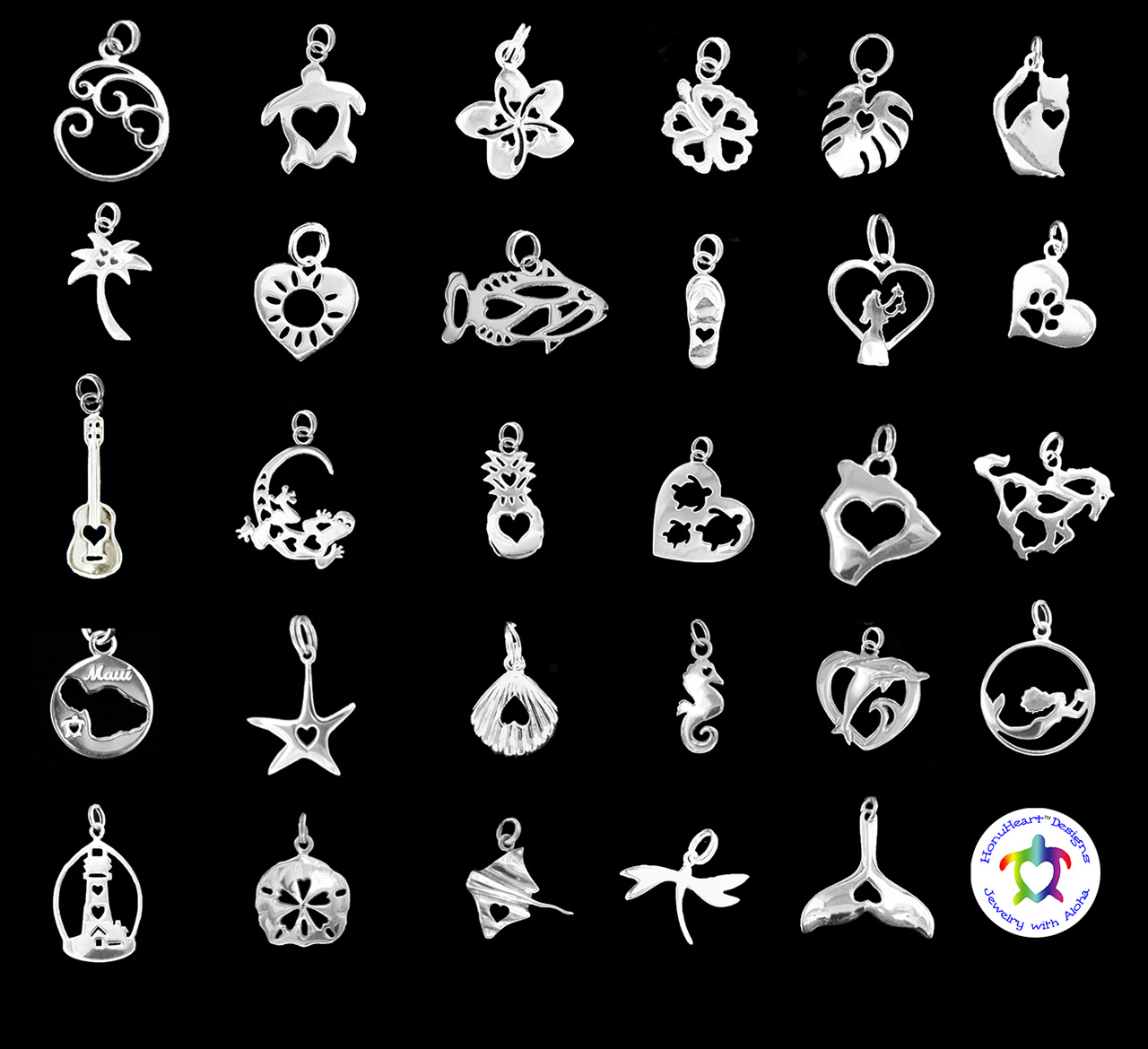 various sterling silver charms with heart cutouts