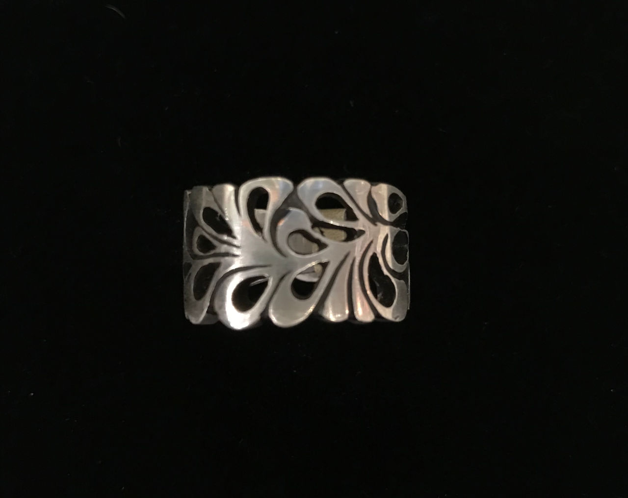 sterling silver ring with many openings that see through to finger. lots of oval shaped designs together