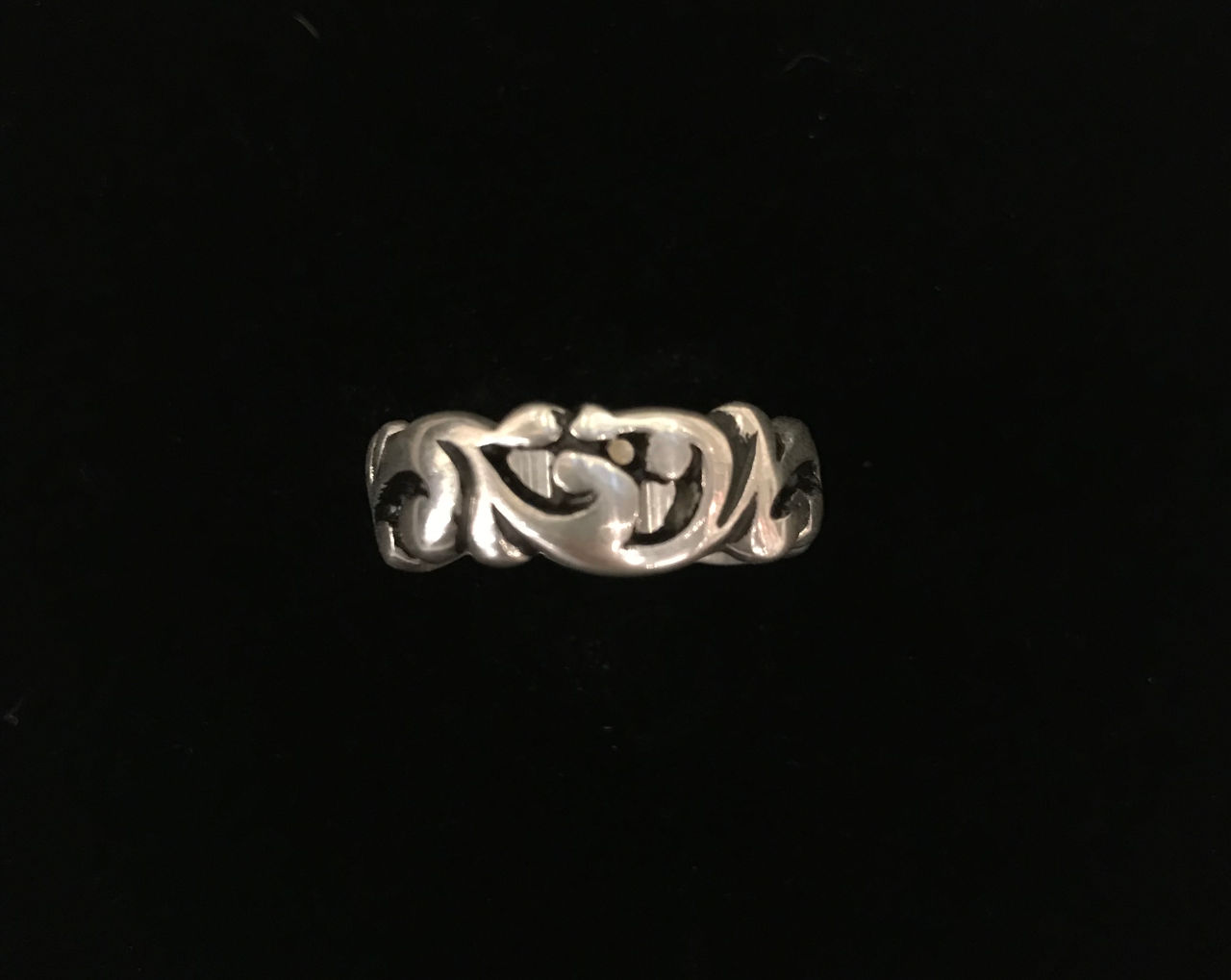 sterling silver ring with flowing lines that fit together without any open space
