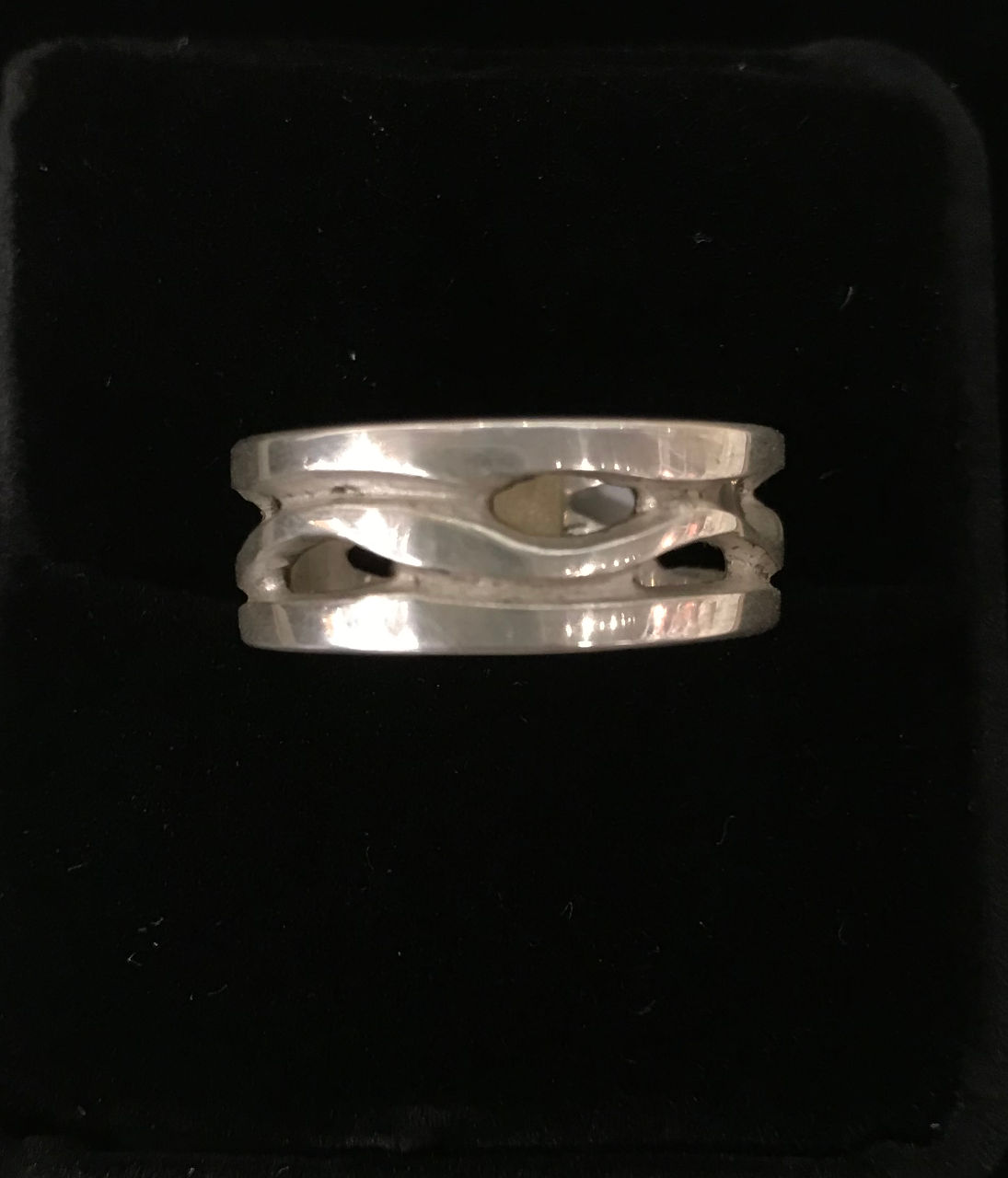 sterling silver ring by Bruce Tapley. Flowing lines, some openeings
