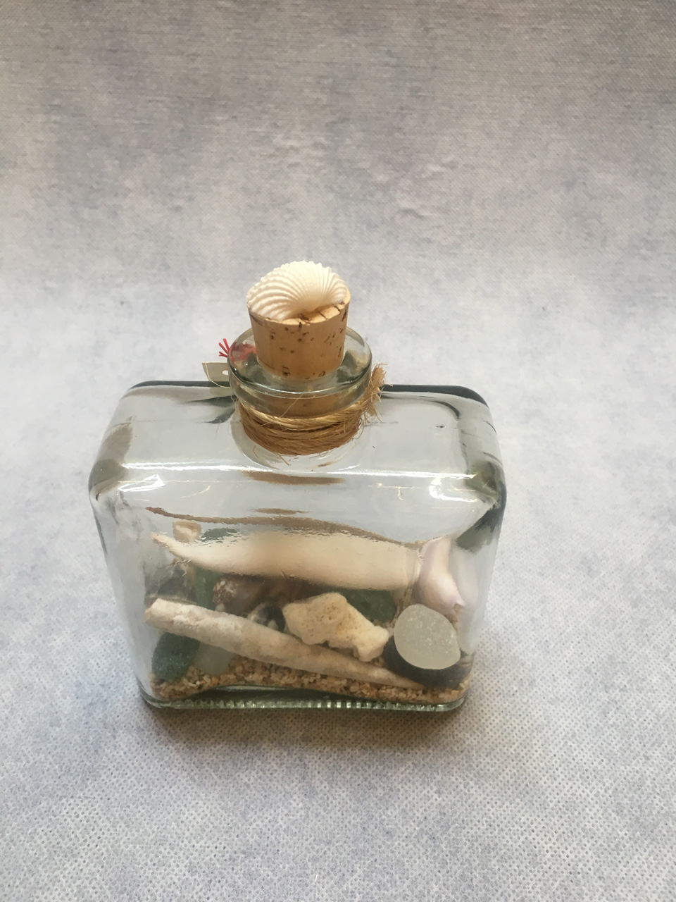 Beach Treasure Bottle by Richard Jordan filled with sea glass and shells