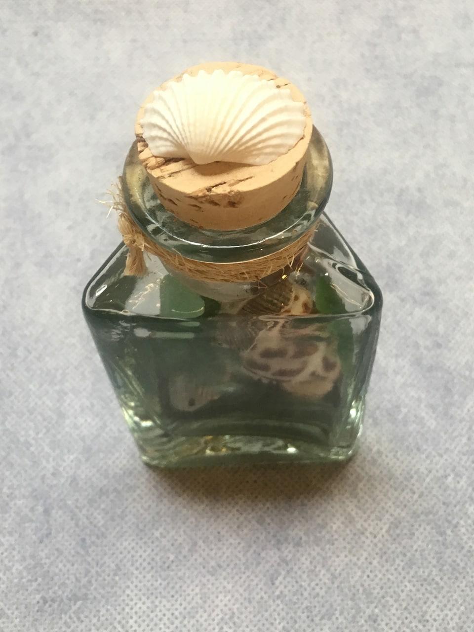 Beach Treasure Bottle by Richard Jordan fill with sea glass and shells