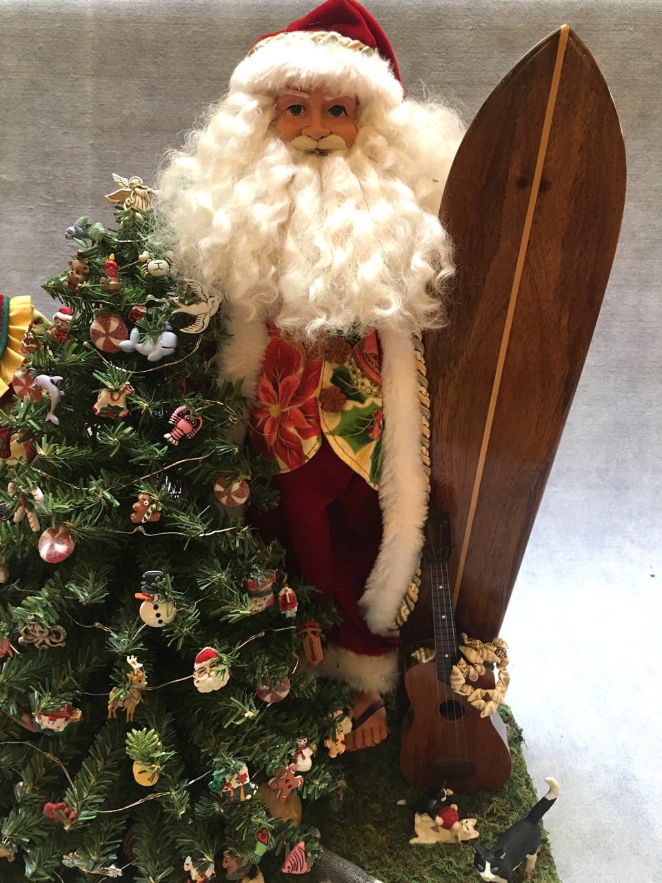 Santa Claus standing by Christmas tree