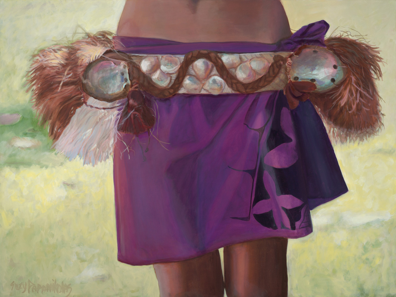 The torso of a female hula dancer wearing purple hula attire