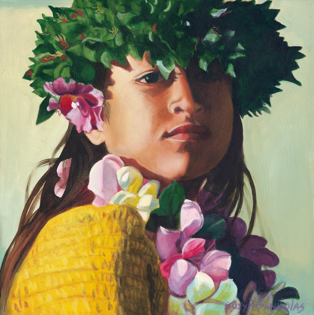 The face of a young hula dancer wearing yellow and a ti leaf haku and a muli color plumeria lei