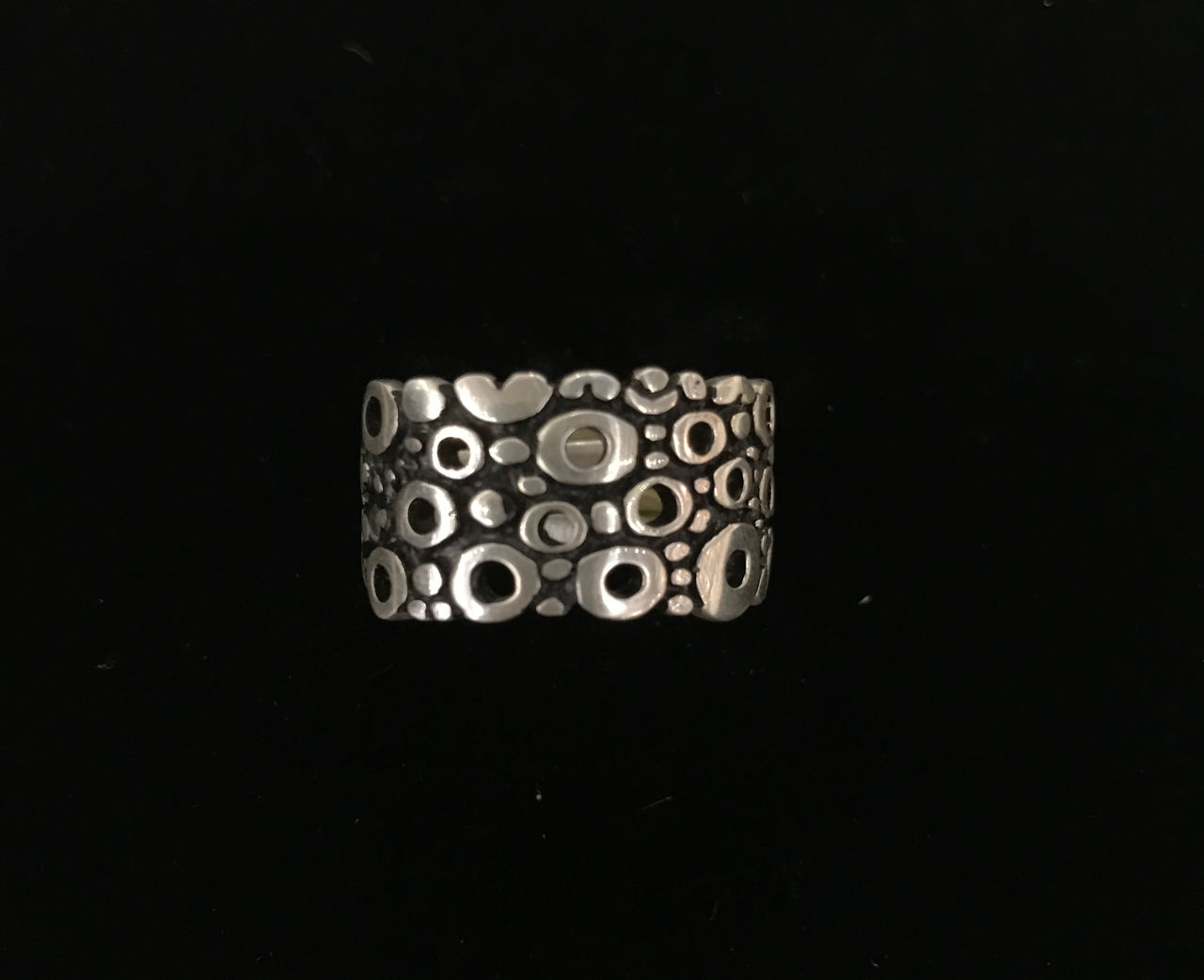 Sterling silver ring with multiple circles some with an open center