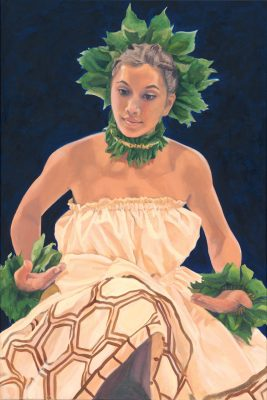 A female hula dancer in motion, wearing brown hula attire and ti leaf accessories