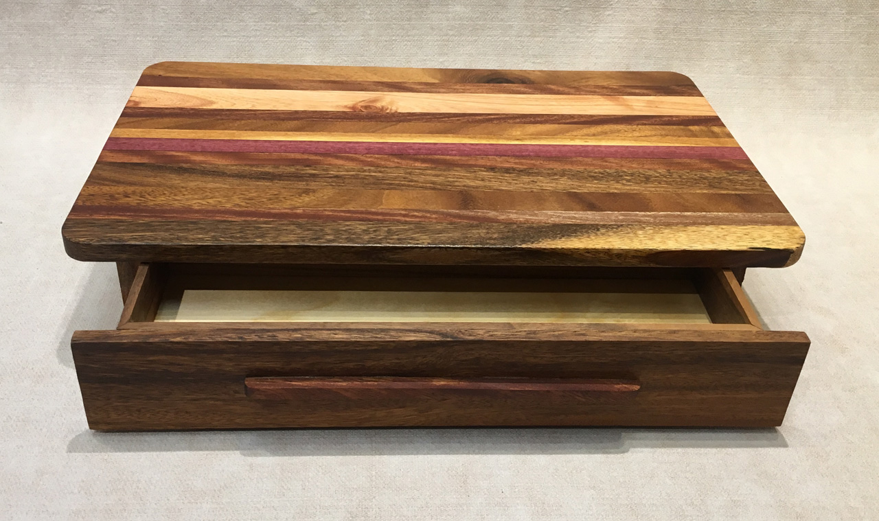 Mixed native hard wood cutting board with pullout drawer by Keoni Woo