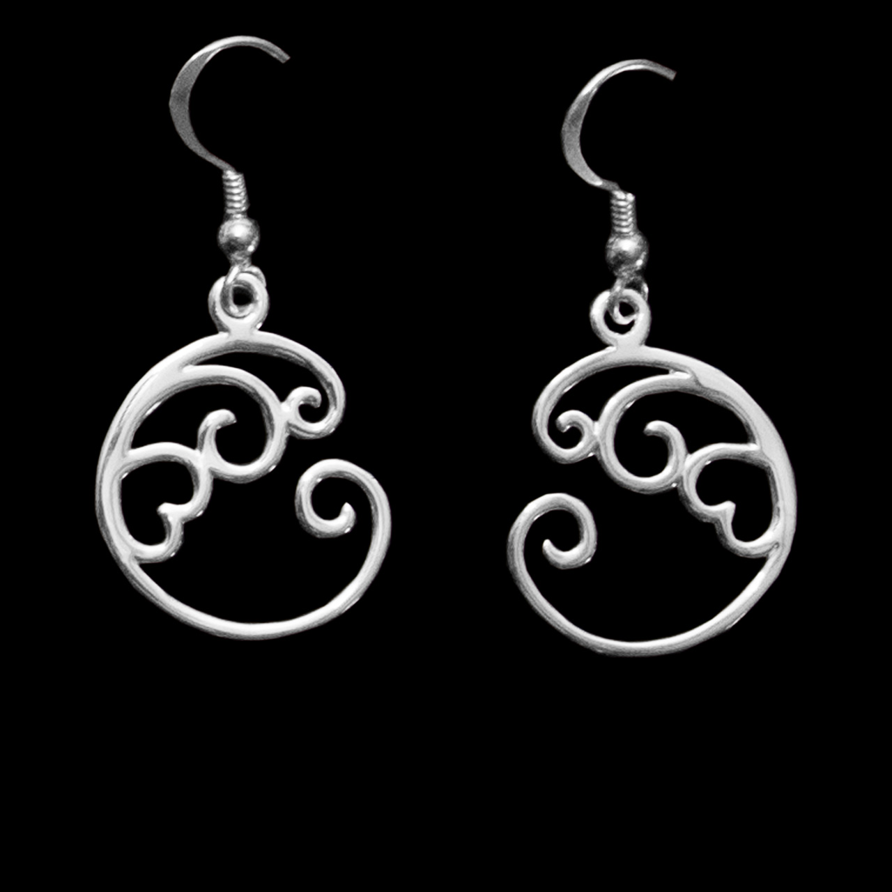 sterling silver wave design earrings with a heart center