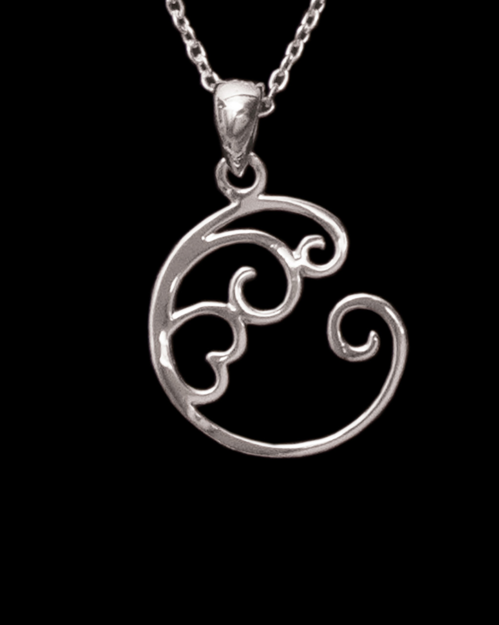 sterling silver necklace of a wave design with a heart in the center