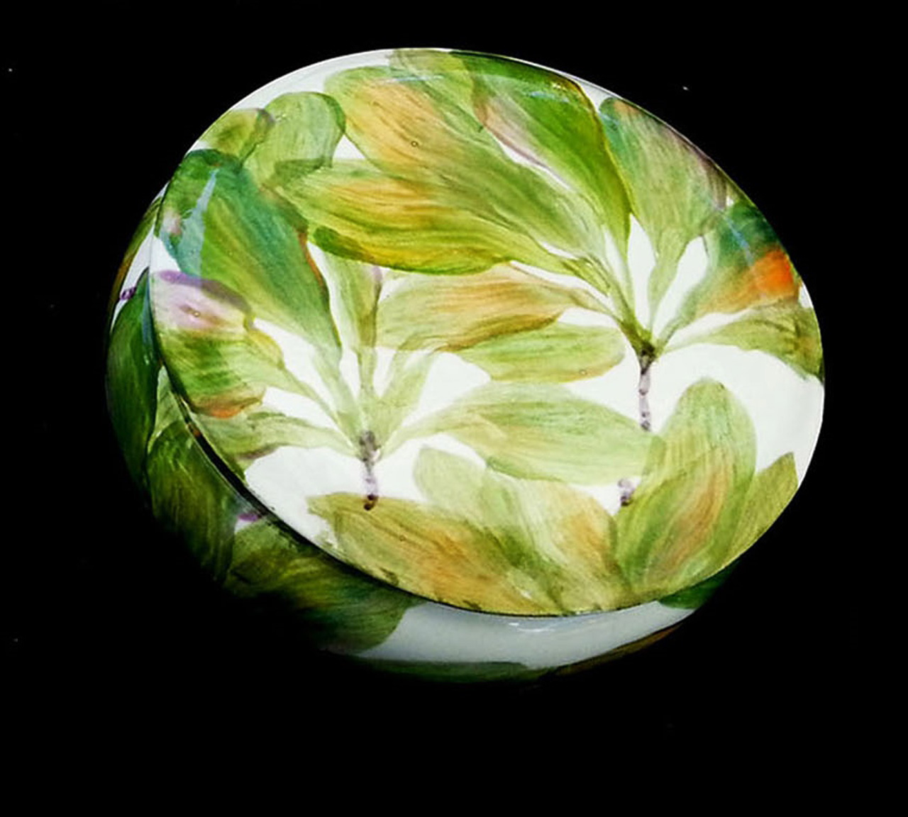 round ceramic lidded box painted ti leaf design