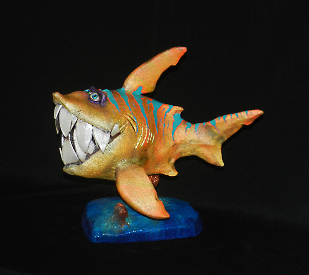 Paia Piranha by Steven Lee Smeltzer cartoonish whimsical clay sculpture of a piranha