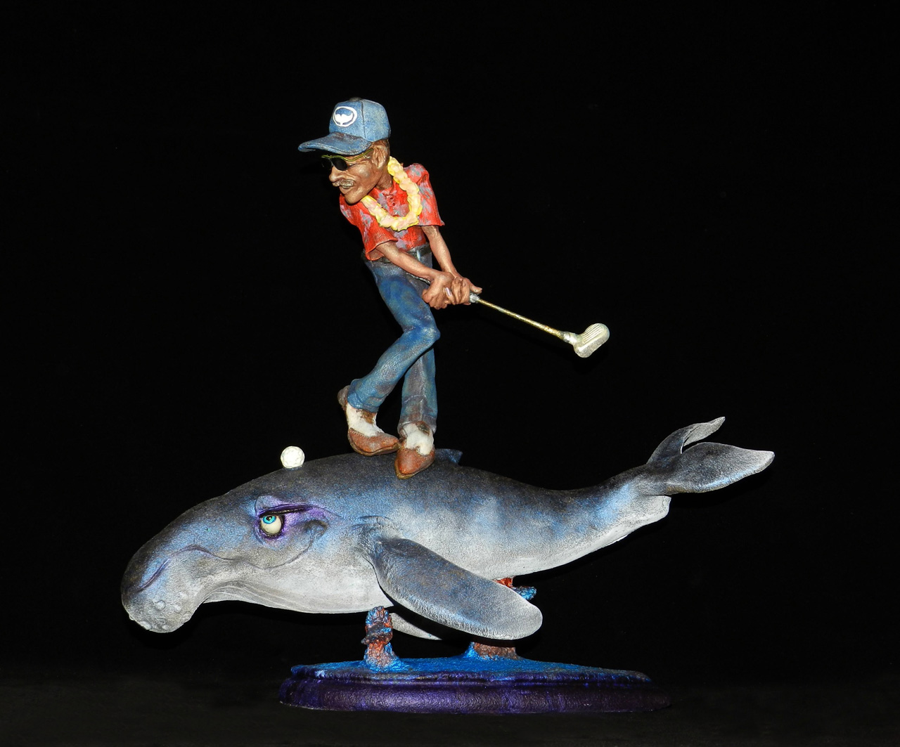 Water Hazard by Steven Lee Smeltzer cartoonish whimsical clay sculpture of golfer on whale