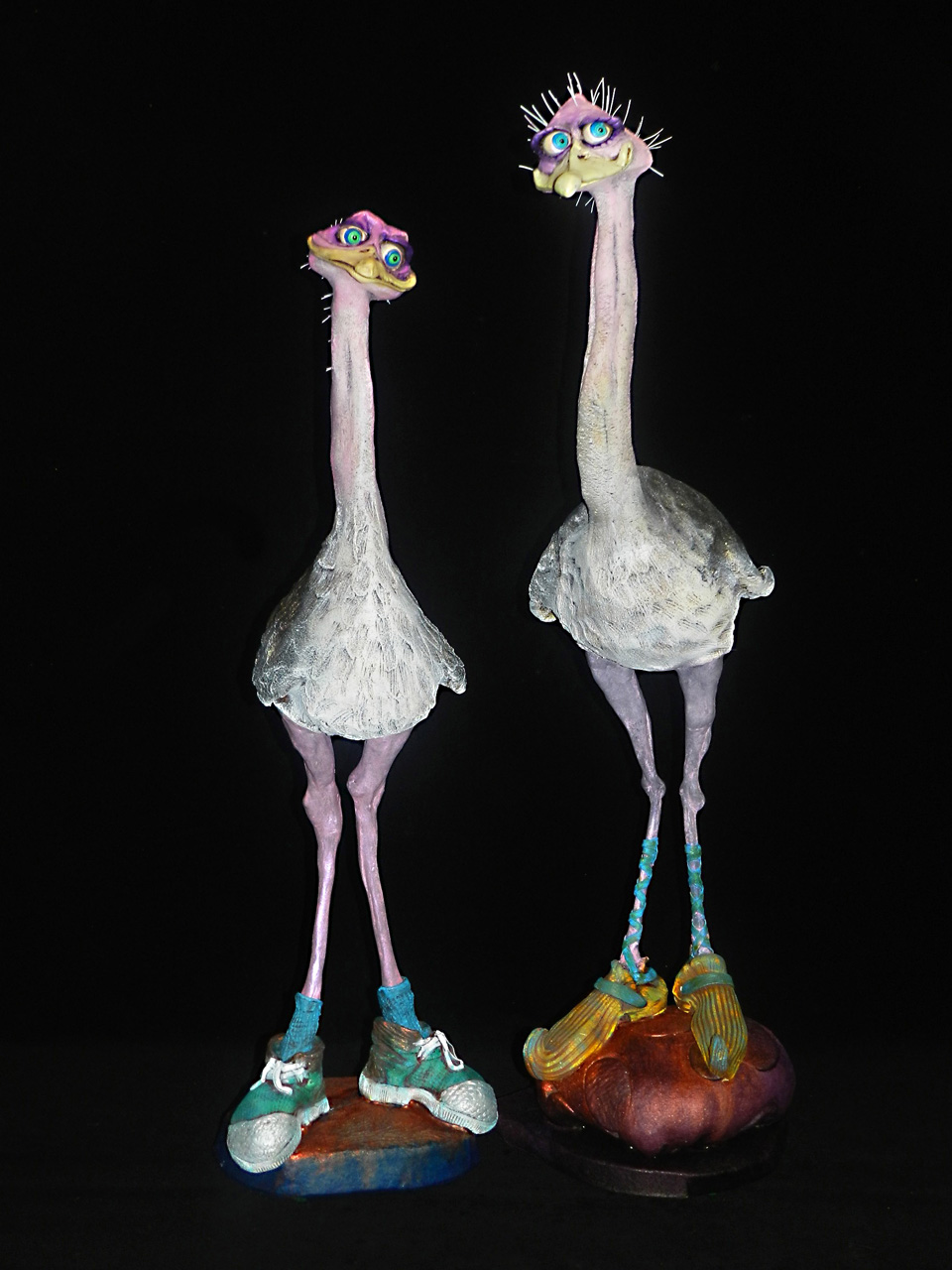 Ostrich by Steven Lee Smeltzer cartoonish whimsical clay sculpture of ostriches